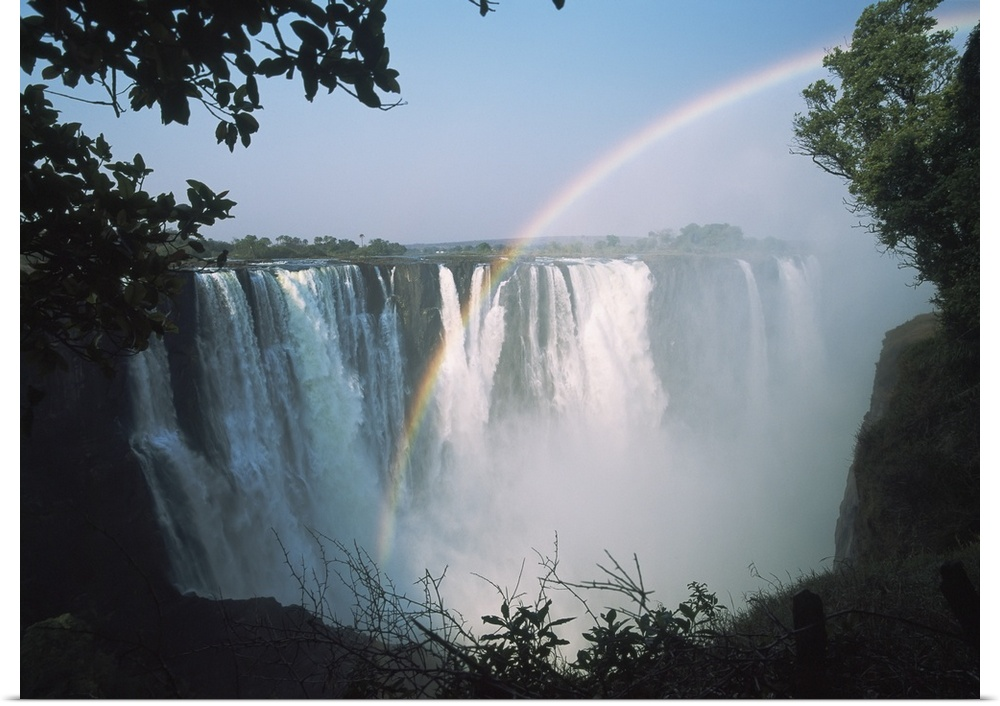 Poster Print Wall Art entitled Rainbow In Front Of Victoria Falls; Zimbabwe