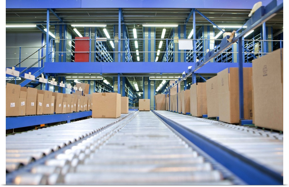 Poster Print Wall Art entitled Boxes on conveyor belts in distribution warehouse