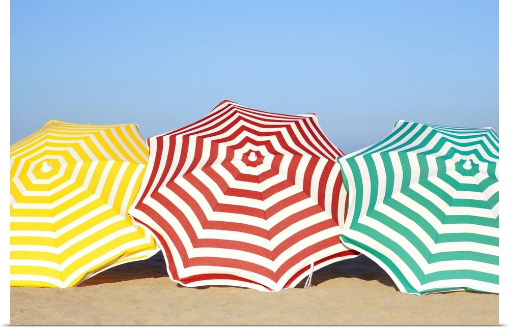 Poster Print Wall Art entitled Coloreeful umbrellas on beach