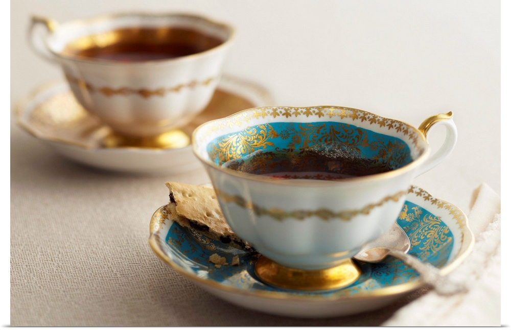 Poster Print Wall Art entitled Elegant tea cups and saucers, close-up