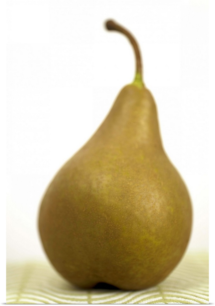 Poster Print Wall Art entitled Pear sitting on a mat