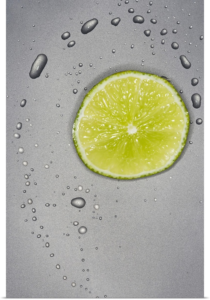 Poster Print Wall Art entitled Sliced limes with water droplets