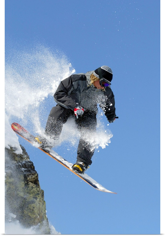 Poster Print Wall Art entitled Snowboarder jumping off ledge