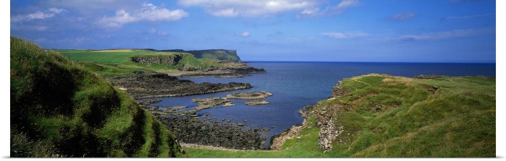 Poster Print Wall Art entitled Lush verde coastal cliffs, blu sea, Northern