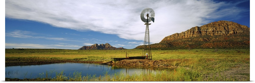 Poster Print Wall Art entitled Solitary windmill near a pond, U.S. Route 89,