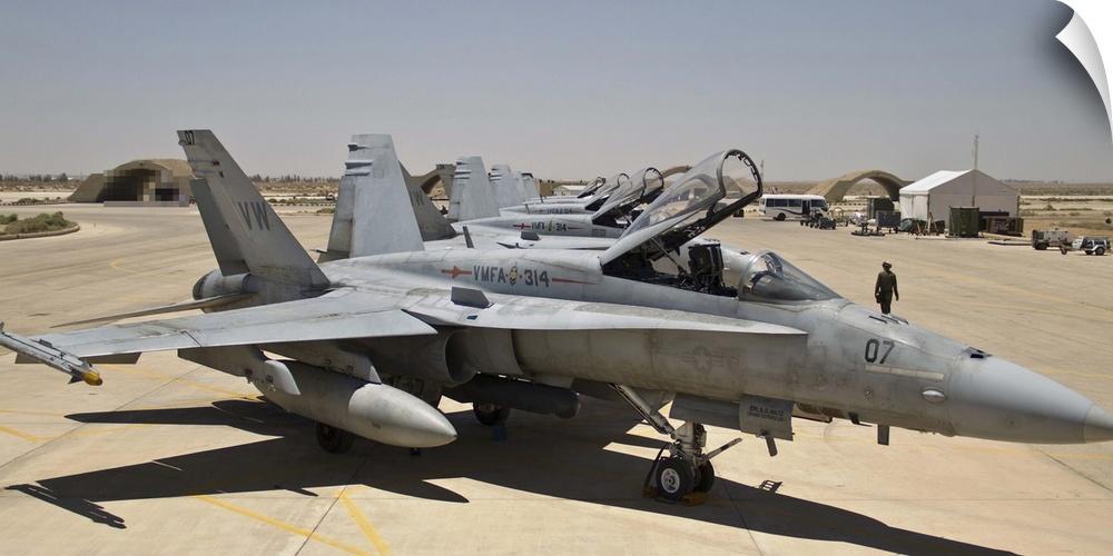 Wall Decal entitled A row of U.S. Marine Corps F-18 Hornets await post-flight