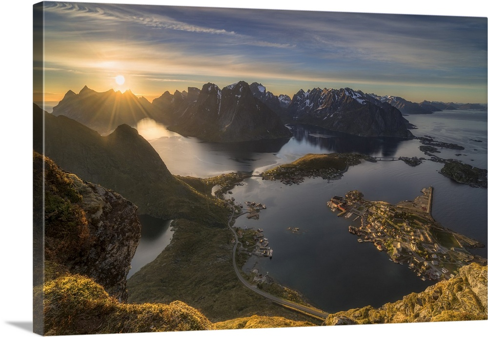 Large Solid-Faced Canvas Print Wall Art Print 30 x 20 entitled Magic Moment Solid-Faced Canvas Print entitled Magic Moment.  Quite a steep trail among grass and rowanberry leads up to Reinebringen 448 meters. At 400m, as you lean over the edge, you will probably shout out with joy at the sight in front of you. Directly below the tips of your shoes lies Reine, bobbing in the sea, fjord and mountain. That magic, happy feeling spreads throughout your entire body.          This particular shot was taken at Midnight with the sun at its lowest position.  Multiple sizes available.  Primary colors within this image include Brown, Peach, Dark Gray, Light Gray.  Made in USA.  Satisfaction guaranteed.  Archival-quality UV-resistant inks.  Archival inks prevent fading and preserve as much fine detail as possible with no over-saturation or color shifting.  Featuring a proprietary design, our canvases produce the tightest corners without any bubbles, ripples, or bumps and will not warp or sag over time.