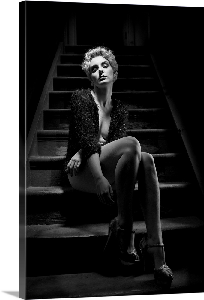 Large Solid-Faced Canvas Print Wall Art Print 20 x 30 entitled Waiting In The Noir Solid-Faced Canvas Print entitled Waiting In The Noir.  A portrait of beautiful woman in lingerie sitting on a steps of a staircase.  Multiple sizes available.  Primary colors within this image include Black, Light Gray.  Made in the USA.  All products come with a 365 day workmanship guarantee.  Inks used are latex-based and designed to last.  Featuring a proprietary design, our canvases produce the tightest corners without any bubbles, ripples, or bumps and will not warp or sag over time.  Canvas depth is 1.25 and includes a finished backing with pre-installed hanging hardware.