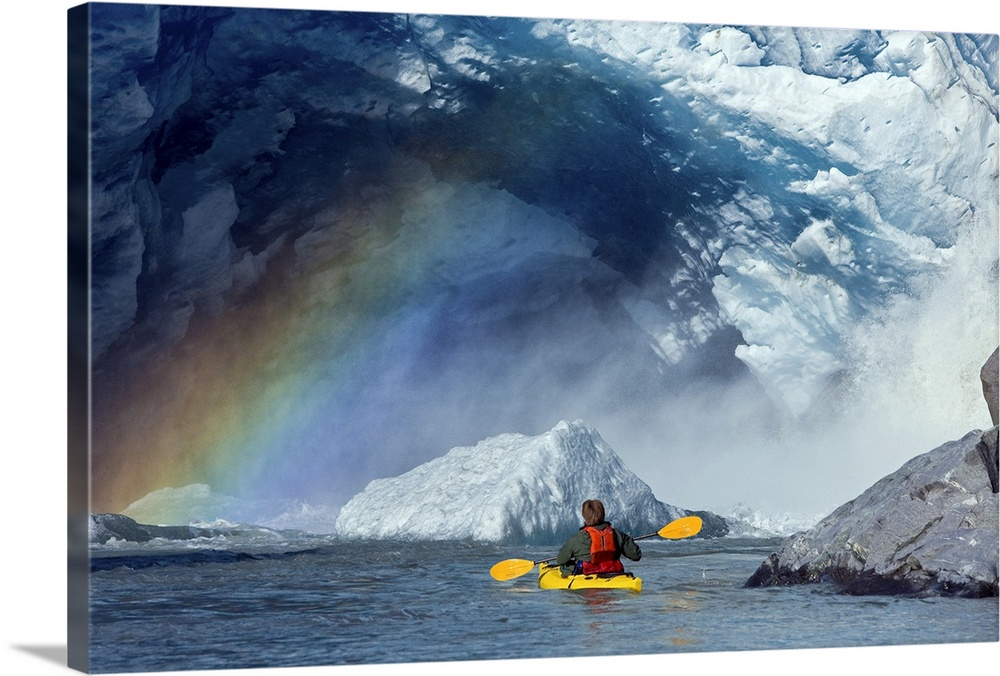 Large Solid-Faced Canvas Print Wall Art Print 30 x 20 entitled A kayaker explores a melt stream gushing from beneath Mende... Solid-Faced Canvas Print entitled A kayaker explores a melt stream gushing from beneath Mendenhall Glacier.  A kayaker explores a melt stream gushing from beneath Mendenhall Glacier, Mendenhall Lake, Tongass National Forest, Juneau, Alaska.  Multiple sizes available.  Primary colors within this image include Orange, White, Gray Blue, Dark Navy Blue.  Made in the USA.  All products come with a 365 day workmanship guarantee.  Inks used are latex-based and designed to last.  Archival inks prevent fading and preserve as much fine detail as possible with no over-saturation or color shifting.  Canvas is handcrafted and made-to-order in the United States using high quality artist-grade canvas.