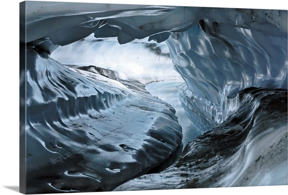 Large Solid-Faced Canvas Print Wall Art Print 30 x 20 entitled A water channel cuts a tunnel through the ice of the Matanu... Solid-Faced Canvas Print entitled A water channel cuts a tunnel through the ice of the Matanuska Glacier.  A photograph inside a tunnel that was formed by a water channel inside a glacier.  Multiple sizes available.  Primary colors within this image include Dark Gray, White, Gray Blue.  Made in USA.  All products come with a 365 day workmanship guarantee.  Archival-quality UV-resistant inks.  Archival inks prevent fading and preserve as much fine detail as possible with no over-saturation or color shifting.  Canvas is handcrafted and made-to-order in the United States using high quality artist-grade canvas.