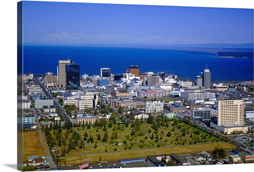 Large Solid-Faced Canvas Print Wall Art Print 30 x 20 entitled Aerial of Anchorage Skyline Summer Alaska Solid-Faced Canvas Print entitled Aerial of Anchorage Skyline Summer Alaska.  Multiple sizes available.  Primary colors within this image include Dark Red, Brown, Royal Blue, Dark Navy Blue.  Made in the USA.  Satisfaction guaranteed.  Inks used are latex-based and designed to last.  Featuring a proprietary design, our canvases produce the tightest corners without any bubbles, ripples, or bumps and will not warp or sag over time.  Canvas depth is 1.25 and includes a finished backing with pre-installed hanging hardware.