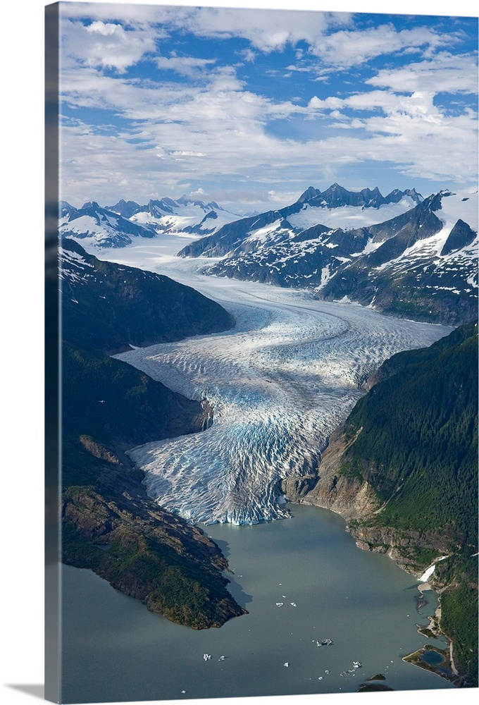 Large Solid-Faced Canvas Print Wall Art Print 20 x 30 entitled Aerial view of Mendenhall Glacier, Juneau Icefield to Mende... Solid-Faced Canvas Print entitled Aerial view of Mendenhall Glacier, Juneau Icefield to Mendenhall Lake in Tongass.  Mendenhall Glacier winds its way down from the Juneau Ice Field to Mendenhall Lake, where the face of the glacier terminates, Tongass Forest, Juneau, Alaska.  Multiple sizes available.  Primary colors within this image include Gray, Silver, Dark Navy Blue.  Made in USA.  All products come with a 365 day workmanship guarantee.  Inks used are latex-based and designed to last.  Featuring a proprietary design, our canvases produce the tightest corners without any bubbles, ripples, or bumps and will not warp or sag over time.  Canvas is handcrafted and made-to-order in the United States using high quality artist-grade canvas.