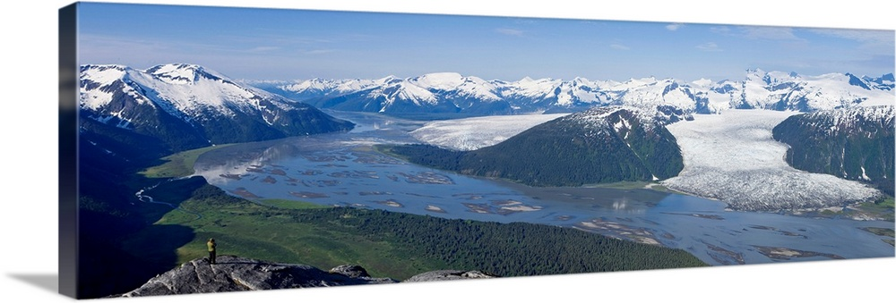 Large Solid-Faced Canvas Print Wall Art Print 48 x 16 entitled Aerial view of Taku River, Taku Glacier and Hole in the Wal... Solid-Faced Canvas Print entitled Aerial view of Taku River, Taku Glacier and Hole in the Wall Glacier, Inside Passage.  Multiple sizes available.  Primary colors within this image include Sky Blue, Black, Dark Forest Green.  Made in the USA.  Satisfaction guaranteed.  Archival-quality UV-resistant inks.  Featuring a proprietary design, our canvases produce the tightest corners without any bubbles, ripples, or bumps and will not warp or sag over time.  Archival inks prevent fading and preserve as much fine detail as possible with no over-saturation or color shifting.