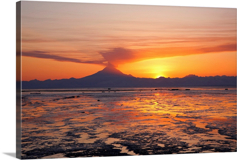 Large Solid-Faced Canvas Print Wall Art Print 30 x 20 entitled Ash cloud rises from Mt. Redoubt at sunset during low tide ... Solid-Faced Canvas Print entitled Ash cloud rises from Mt. Redoubt at sunset during low tide near Ninilchik, Alaska.  Multiple sizes available.  Primary colors within this image include Orange, Dark Red, Light Yellow, Black.  Made in the USA.  All products come with a 365 day workmanship guarantee.  Archival-quality UV-resistant inks.  Canvas is handcrafted and made-to-order in the United States using high quality artist-grade canvas.  Featuring a proprietary design, our canvases produce the tightest corners without any bubbles, ripples, or bumps and will not warp or sag over time.