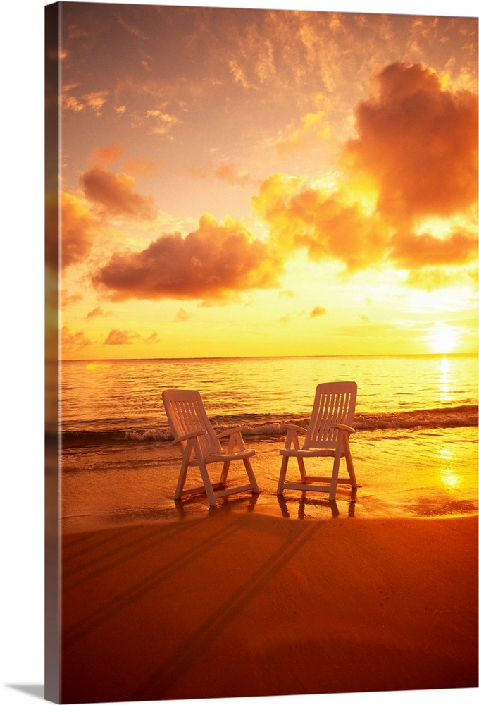 Large Solid-Faced Canvas Print Wall Art Print 20 x 30 entitled Beach Chairs Along Shoreline At Sunset Solid-Faced Canvas Print entitled Beach Chairs Along Shoreline At Sunset.  Multiple sizes available.  Primary colors within this image include Orange, Yellow, Dark Red, Peach.  Made in USA.  All products come with a 365 day workmanship guarantee.  Inks used are latex-based and designed to last.  Canvas is handcrafted and made-to-order in the United States using high quality artist-grade canvas.  Canvas depth is 1.25 and includes a finished backing with pre-installed hanging hardware.