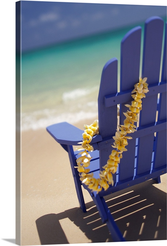 Large Solid-Faced Canvas Print Wall Art Print 20 x 30 entitled Blue Beach Chair With Plumeria Lei Hanging On Side Solid-Faced Canvas Print entitled Blue Beach Chair With Plumeria Lei Hanging On Side.  Multiple sizes available.  Primary colors within this image include Dark Yellow, Silver, Muted Blue, Gray Blue.  Made in the USA.  All products come with a 365 day workmanship guarantee.  Archival-quality UV-resistant inks.  Canvas is handcrafted and made-to-order in the United States using high quality artist-grade canvas.  Featuring a proprietary design, our canvases produce the tightest corners without any bubbles, ripples, or bumps and will not warp or sag over time.