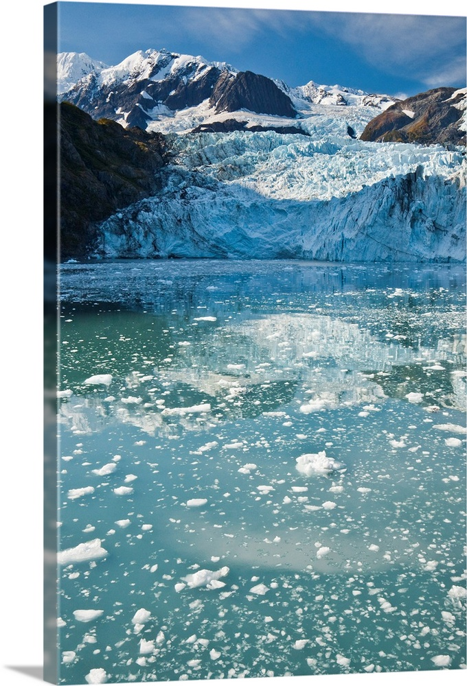 Large Solid-Faced Canvas Print Wall Art Print 20 x 30 entitled Chunks of melted ice float in water near glacier Solid-Faced Canvas Print entitled Chunks of melted ice float in water near glacier.  Multiple sizes available.  Primary colors within this image include White, Gray Blue, Dark Navy Blue.  Made in the USA.  Satisfaction guaranteed.  Archival-quality UV-resistant inks.  Archival inks prevent fading and preserve as much fine detail as possible with no over-saturation or color shifting.  Canvas depth is 1.25 and includes a finished backing with pre-installed hanging hardware.