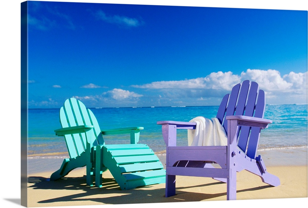 Large Solid-Faced Canvas Print Wall Art Print 30 x 20 entitled Colorful Beach Chairs On Beach, Calm Waves Washing Ashore Solid-Faced Canvas Print entitled Colorful Beach Chairs On Beach, Calm Waves Washing Ashore.  Photograph of pastel colored chairs on the shoreline under a cloudy sky.  Multiple sizes available.  Primary colors within this image include Forest Green, Dark Blue, Pale Blue, Royal Blue.  Made in USA.  All products come with a 365 day workmanship guarantee.  Archival-quality UV-resistant inks.  Canvas is handcrafted and made-to-order in the United States using high quality artist-grade canvas.  Canvas depth is 1.25 and includes a finished backing with pre-installed hanging hardware.