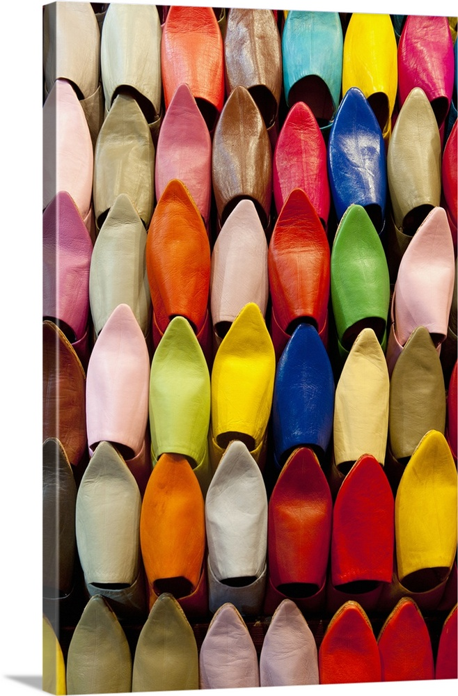 Large Solid-Faced Canvas Print Wall Art Print 20 x 30 entitled Colorful Shoes In A Market In Marrakesh, Morocco Solid-Faced Canvas Print entitled Colorful Shoes In A Market In Marrakesh, Morocco.  Multiple sizes available.  Primary colors within this image include Orange, Yellow, Dark Red, Black.  Made in USA.  Satisfaction guaranteed.  Archival-quality UV-resistant inks.  Featuring a proprietary design, our canvases produce the tightest corners without any bubbles, ripples, or bumps and will not warp or sag over time.  Canvas depth is 1.25 and includes a finished backing with pre-installed hanging hardware.