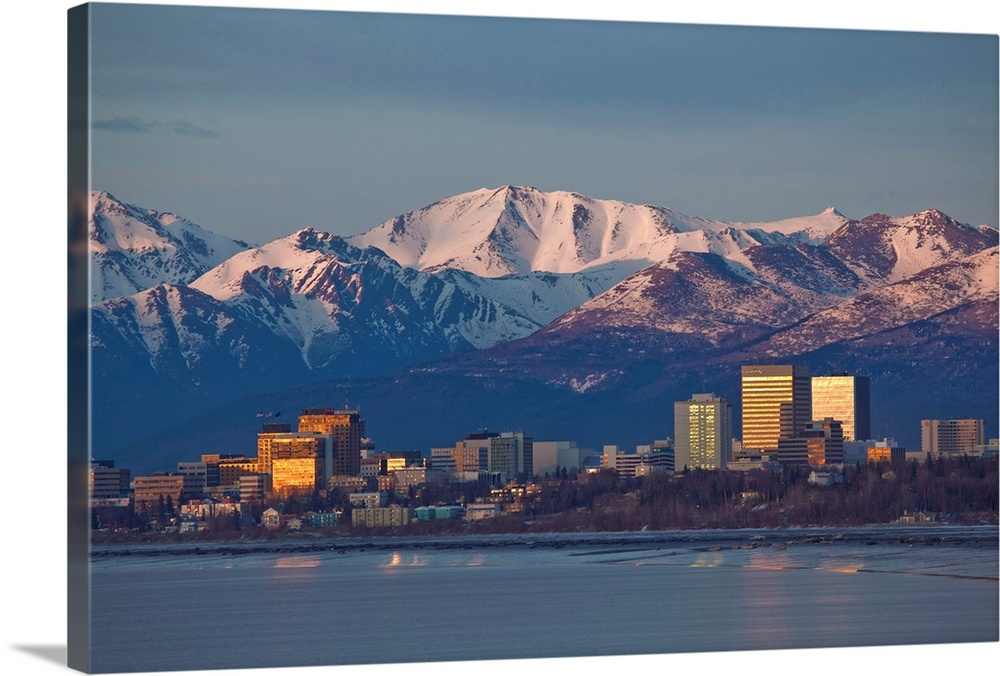 Large Solid-Faced Canvas Print Wall Art Print 30 x 20 entitled Downtown Anchorage Skyline, Spring, Southcentral Alaska Solid-Faced Canvas Print entitled Downtown Anchorage Skyline, Spring, Southcentral Alaska.  Multiple sizes available.  Primary colors within this image include Orange, Light Yellow, Light Gray, Dark Navy Blue.  Made in the USA.  Satisfaction guaranteed.  Inks used are latex-based and designed to last.  Archival inks prevent fading and preserve as much fine detail as possible with no over-saturation or color shifting.  Canvas depth is 1.25 and includes a finished backing with pre-installed hanging hardware.