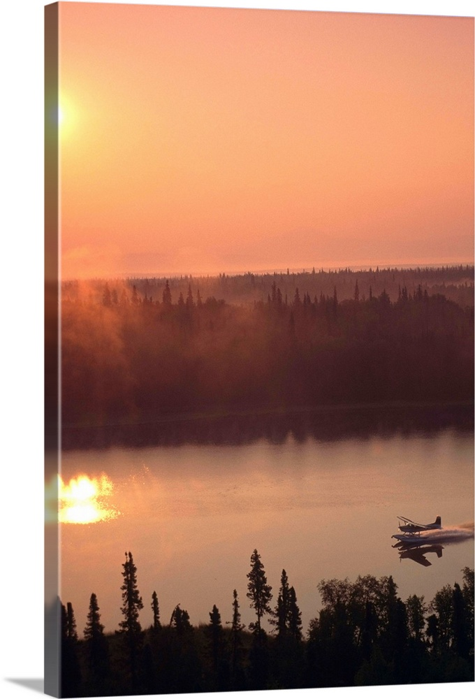 Large Solid-Faced Canvas Print Wall Art Print 20 x 30 entitled Floatplane Landing at Sunset on Lake Matanuska Valley, Alaska Solid-Faced Canvas Print entitled Floatplane Landing at Sunset on Lake Matanuska Valley, Alaska.  Multiple sizes available.  Primary colors within this image include Peach, Dark Gray, White.  Made in the USA.  Satisfaction guaranteed.  Archival-quality UV-resistant inks.  Featuring a proprietary design, our canvases produce the tightest corners without any bubbles, ripples, or bumps and will not warp or sag over time.  Canvas depth is 1.25 and includes a finished backing with pre-installed hanging hardware.