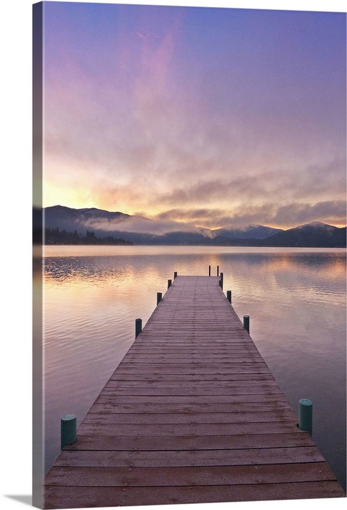 Large Solid-Faced Canvas Print Wall Art Print 20 x 30 entitled Footprints leading down a frost covered dock at sunrise on ... Solid-Faced Canvas Print entitled Footprints leading down a frost covered dock at sunrise on Lake Whatcom during Winter.  Footprints leading down a frost covered dock at sunrise on Lake Whatcom during Winter, Bellingham Washington, USA.  Multiple sizes available.  Primary colors within this image include Peach, Dark Gray, Royal Blue.  Made in the USA.  All products come with a 365 day workmanship guarantee.  Inks used are latex-based and designed to last.  Archival inks prevent fading and preserve as much fine detail as possible with no over-saturation or color shifting.  Canvas depth is 1.25 and includes a finished backing with pre-installed hanging hardware.