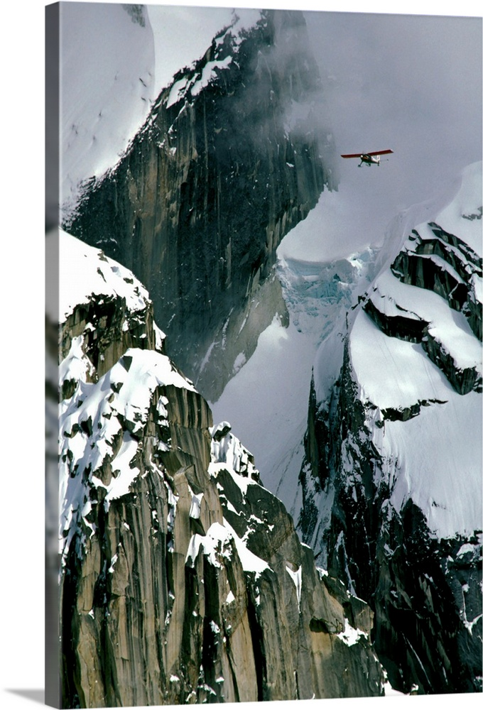 Large Solid-Faced Canvas Print Wall Art Print 20 x 30 entitled Glacier pilot and plane in AK Range Mooses Tooth Solid-Faced Canvas Print entitled Glacier pilot and plane in AK Range Mooses Tooth.  Multiple sizes available.  Primary colors within this image include Black, White, Light Gray Blue.  Made in the USA.  Satisfaction guaranteed.  Archival-quality UV-resistant inks.  Featuring a proprietary design, our canvases produce the tightest corners without any bubbles, ripples, or bumps and will not warp or sag over time.  Canvas depth is 1.25 and includes a finished backing with pre-installed hanging hardware.