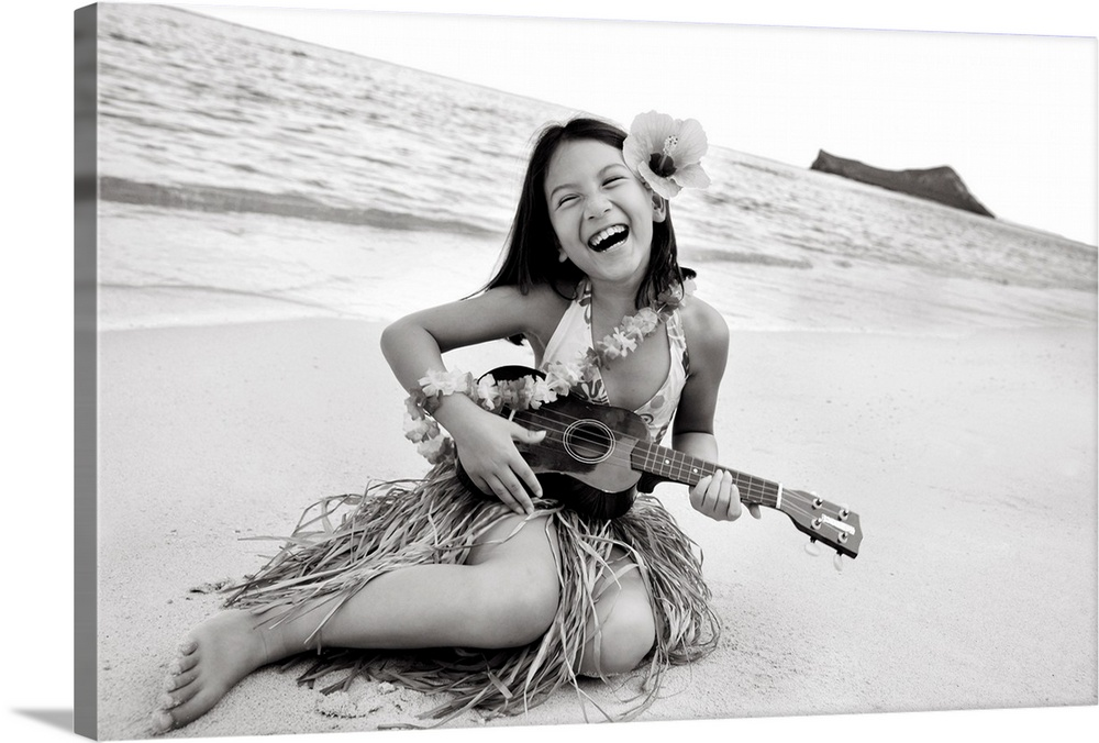 Large Gallery-Wrapped Canvas Wall Art Print 24 x 16 entitled Hawaii, Oahu, Young Girl Smiling And Playing Ukulele On The B... Gallery-Wrapped Canvas entitled Hawaii Oahu Young Girl Smiling And Playing Ukulele On The Beach In A Hula Skirt.  Multiple sizes available.  Primary colors within this image include Black Gray White.  Made in USA.  Satisfaction guaranteed.  Inks used are latex-based and designed to last.  Canvas is a 65 polyester 35 cotton base with two acrylic latex primer basecoats and a semi-gloss inkjet receptive topcoat.  Canvases have a UVB protection built in to protect against fading and moisture and are designed to last for over 100 years.