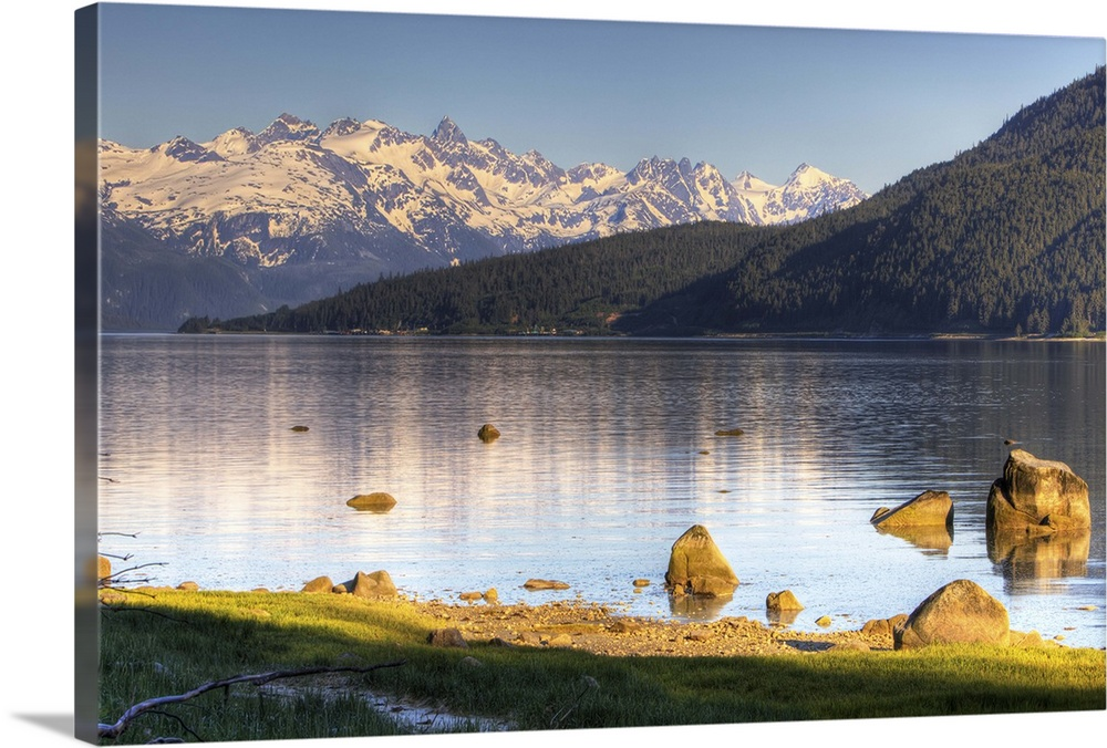 Large Solid-Faced Canvas Print Wall Art Print 30 x 20 entitled Just outside of Haines, Alaska Solid-Faced Canvas Print entitled Just outside of Haines, Alaska.  Multiple sizes available.  Primary colors within this image include Light Yellow, Dark Gray, Light Gray, White.  Made in USA.  Satisfaction guaranteed.  Archival-quality UV-resistant inks.  Canvas depth is 1.25 and includes a finished backing with pre-installed hanging hardware.  Archival inks prevent fading and preserve as much fine detail as possible with no over-saturation or color shifting.