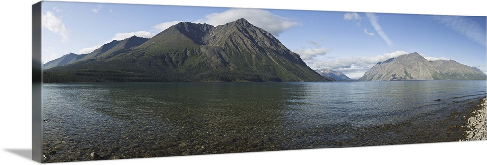 Large Solid-Faced Canvas Print Wall Art Print 48 x 16 entitled Kathleen Lake with Kings Throne mountain in Kluane National... Solid-Faced Canvas Print entitled Kathleen Lake with Kings Throne mountain in Kluane National Park near Haines Junction.  Multiple sizes available.  Primary colors within this image include Sky Blue, Gray.  Made in the USA.  All products come with a 365 day workmanship guarantee.  Inks used are latex-based and designed to last.  Featuring a proprietary design, our canvases produce the tightest corners without any bubbles, ripples, or bumps and will not warp or sag over time.  Archival inks prevent fading and preserve as much fine detail as possible with no over-saturation or color shifting.
