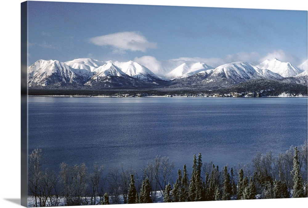 Large Solid-Faced Canvas Print Wall Art Print 30 x 20 entitled Lake Clark & Mountains Lake Clark NP Winter AK Solid-Faced Canvas Print entitled Lake Clark  Mountains Lake Clark NP Winter AK.  Multiple sizes available.  Primary colors within this image include Black, White, Gray Blue.  Made in the USA.  Satisfaction guaranteed.  Inks used are latex-based and designed to last.  Canvas depth is 1.25 and includes a finished backing with pre-installed hanging hardware.  Archival inks prevent fading and preserve as much fine detail as possible with no over-saturation or color shifting.