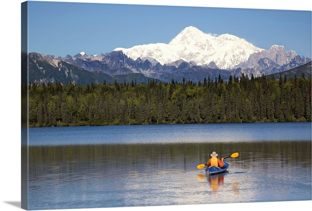 Large Solid-Faced Canvas Print Wall Art Print 30 x 20 entitled Man paddling a Klepper kayak on Byers Lake at Denali State ... Solid-Faced Canvas Print entitled Man paddling a Klepper kayak on Byers Lake at Denali State Park with Mt. McKinley.  A man paddles a Klepper kayak on Byers Lake, Denali State Park, Alaska. Mt. McKinley is in the background. August.  Multiple sizes available.  Primary colors within this image include Sky Blue, White, Muted Blue, Dark Forest Green.  Made in the USA.  Satisfaction guaranteed.  Inks used are latex-based and designed to last.  Canvas is handcrafted and made-to-order in the United States using high quality artist-grade canvas.  Featuring a proprietary design, our canvases produce the tightest corners without any bubbles, ripples, or bumps and will not warp or sag over time.