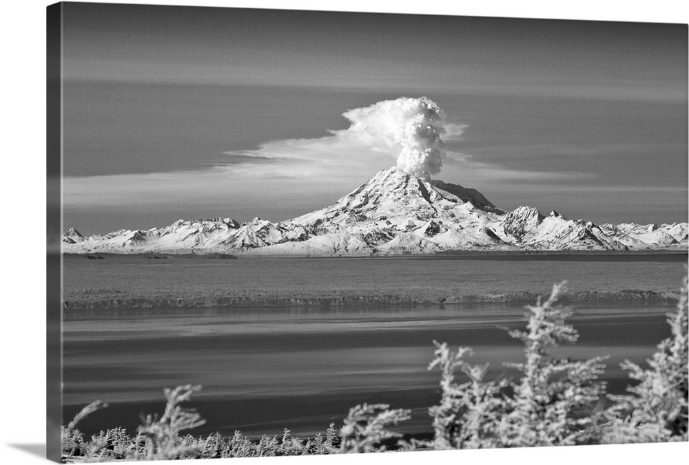Large Solid-Faced Canvas Print Wall Art Print 30 x 20 entitled Mountain erupts with a cloud of ash Solid-Faced Canvas Print entitled Mountain erupts with a cloud of ash.  Multiple sizes available.  Primary colors within this image include Black, Gray, White.  Made in the USA.  Satisfaction guaranteed.  Inks used are latex-based and designed to last.  Featuring a proprietary design, our canvases produce the tightest corners without any bubbles, ripples, or bumps and will not warp or sag over time.  Canvas is handcrafted and made-to-order in the United States using high quality artist-grade canvas.