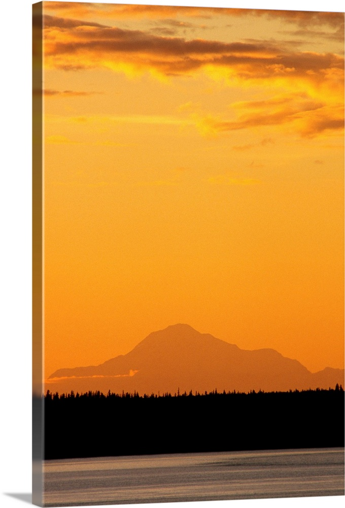 Large Solid-Faced Canvas Print Wall Art Print 20 x 30 entitled Mt Mckinley at Sunset as Seen From Anchorage SC Alaska Solid-Faced Canvas Print entitled Mt Mckinley at Sunset as Seen From Anchorage SC Alaska.  Multiple sizes available.  Primary colors within this image include Orange, Black, Gray.  Made in the USA.  All products come with a 365 day workmanship guarantee.  Archival-quality UV-resistant inks.  Canvas is handcrafted and made-to-order in the United States using high quality artist-grade canvas.  Featuring a proprietary design, our canvases produce the tightest corners without any bubbles, ripples, or bumps and will not warp or sag over time.