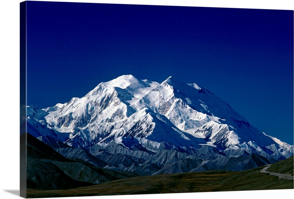 Large Solid-Faced Canvas Print Wall Art Print 30 x 20 entitled Mt McKinley Denali National Park Interior Alaska Solid-Faced Canvas Print entitled Mt McKinley Denali National Park Interior Alaska.  Multiple sizes available.  Primary colors within this image include Dark Blue, Black, White, Muted Blue.  Made in the USA.  All products come with a 365 day workmanship guarantee.  Archival-quality UV-resistant inks.  Featuring a proprietary design, our canvases produce the tightest corners without any bubbles, ripples, or bumps and will not warp or sag over time.  Canvas is handcrafted and made-to-order in the United States using high quality artist-grade canvas.