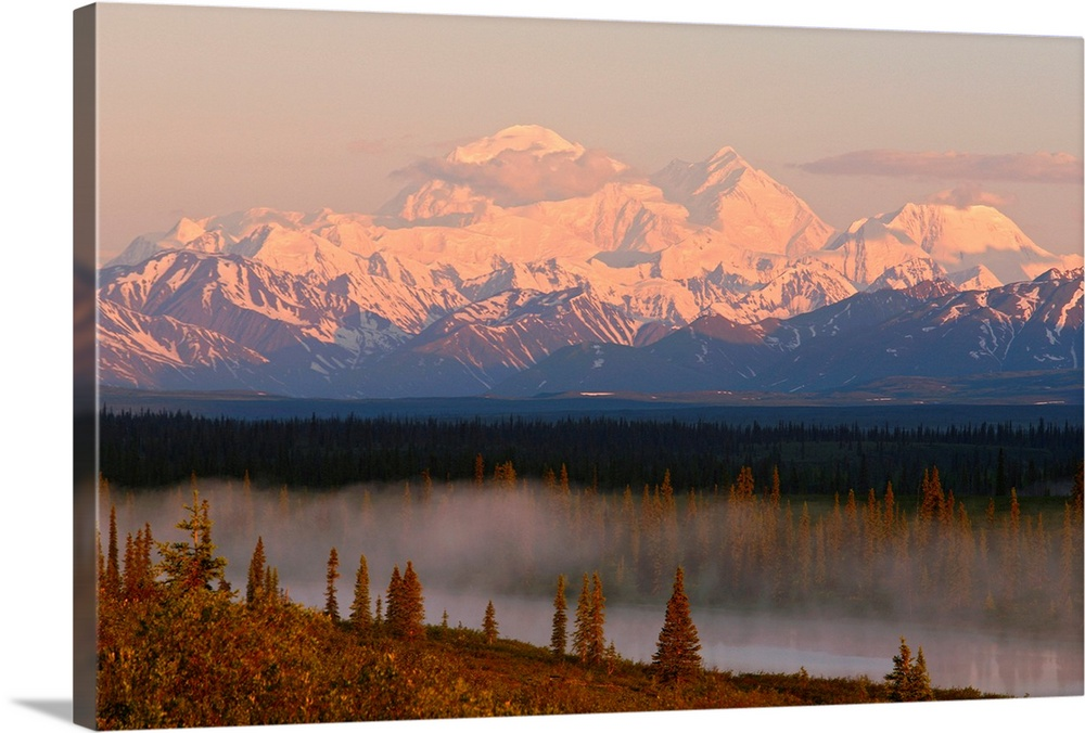 Large Solid-Faced Canvas Print Wall Art Print 30 x 20 entitled Mt. Mckinley reflected in small lake at sunrise in Broad Pa... Solid-Faced Canvas Print entitled Mt. Mckinley reflected in small lake at sunrise in Broad Pass, Denali National Park.  Multiple sizes available.  Primary colors within this image include Brown, Peach, Black, Gray.  Made in the USA.  All products come with a 365 day workmanship guarantee.  Inks used are latex-based and designed to last.  Canvas is handcrafted and made-to-order in the United States using high quality artist-grade canvas.  Featuring a proprietary design, our canvases produce the tightest corners without any bubbles, ripples, or bumps and will not warp or sag over time.