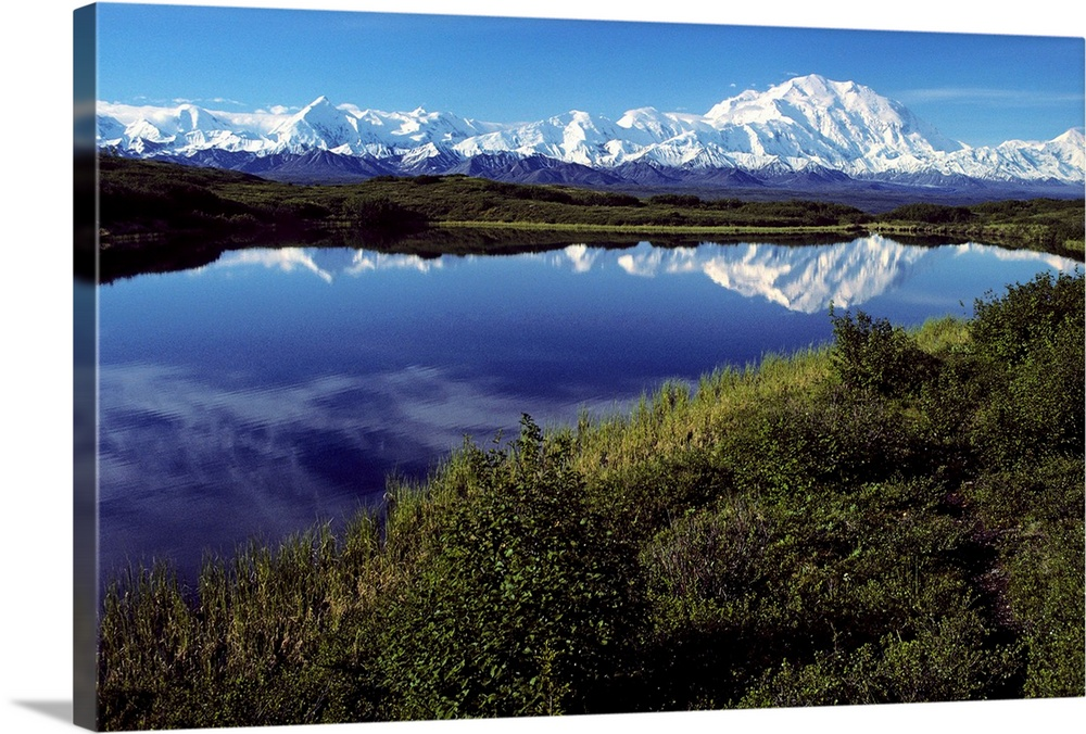 Large Solid-Faced Canvas Print Wall Art Print 30 x 20 entitled Mt McKinley Reflected in Tundra Pond Denali NP AK Solid-Faced Canvas Print entitled Mt McKinley Reflected in Tundra Pond Denali NP AK.  Multiple sizes available.  Primary colors within this image include Dark Yellow, Sky Blue, Black, White.  Made in USA.  All products come with a 365 day workmanship guarantee.  Archival-quality UV-resistant inks.  Canvas is handcrafted and made-to-order in the United States using high quality artist-grade canvas.  Featuring a proprietary design, our canvases produce the tightest corners without any bubbles, ripples, or bumps and will not warp or sag over time.