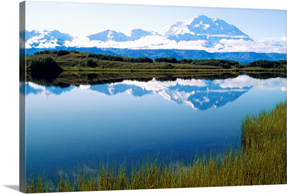 Large Solid-Faced Canvas Print Wall Art Print 30 x 20 entitled Mt McKinley Reflected in Tundra Pond Denali NP AK Solid-Faced Canvas Print entitled Mt McKinley Reflected in Tundra Pond Denali NP AK.  Multiple sizes available.  Primary colors within this image include Sky Blue, Black, White, Muted Blue.  Made in the USA.  Satisfaction guaranteed.  Archival-quality UV-resistant inks.  Archival inks prevent fading and preserve as much fine detail as possible with no over-saturation or color shifting.  Canvas is handcrafted and made-to-order in the United States using high quality artist-grade canvas.