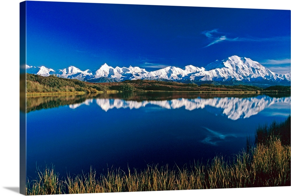 Large Solid-Faced Canvas Print Wall Art Print 30 x 20 entitled Mt McKinley Relfected in Wonder Lake Denali NP AK Solid-Faced Canvas Print entitled Mt McKinley Relfected in Wonder Lake Denali NP AK.  Multiple sizes available.  Primary colors within this image include Dark Blue, Dark Forest Green, Royal Blue, Dark Navy Blue.  Made in the USA.  Satisfaction guaranteed.  Archival-quality UV-resistant inks.  Archival inks prevent fading and preserve as much fine detail as possible with no over-saturation or color shifting.  Canvas depth is 1.25 and includes a finished backing with pre-installed hanging hardware.