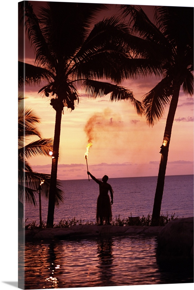 Large Gallery-Wrapped Canvas Wall Art Print 16 x 24 entitled Native In A Grass Skirt Holding A Flaming Torch By Coast At S... Gallery-Wrapped Canvas entitled Native In A Grass Skirt Holding A Flaming Torch By Coast At Sunset.  Multiple sizes available.  Primary colors within this image include Brown Pink Peach Black.  Made in USA.  All products come with a 365 day workmanship guarantee.  Archival-quality UV-resistant inks.  Canvas frames are built with farmed or reclaimed domestic pine or poplar wood.  Canvases are stretched across a 1.5 inch thick wooden frame with easy-to-mount hanging hardware.