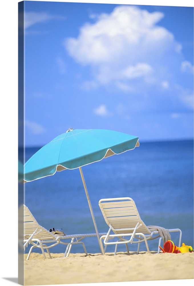 Large Solid-Faced Canvas Print Wall Art Print 20 x 30 entitled Pair Of Beach Chairs And An Umbrella On White Sand Beach Wi... Solid-Faced Canvas Print entitled Pair Of Beach Chairs And An Umbrella On White Sand Beach With Blue Skies And Water.  Multiple sizes available.  Primary colors within this image include Yellow, Sky Blue, White, Gray Blue.  Made in USA.  Satisfaction guaranteed.  Inks used are latex-based and designed to last.  Canvas is handcrafted and made-to-order in the United States using high quality artist-grade canvas.  Archival inks prevent fading and preserve as much fine detail as possible with no over-saturation or color shifting.