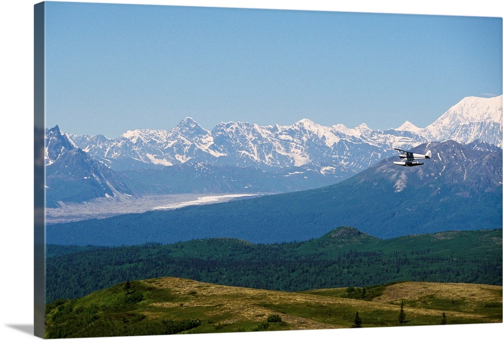 Large Solid-Faced Canvas Print Wall Art Print 30 x 20 entitled Piper Supercub on Floats Over Alaska Range Solid-Faced Canvas Print entitled Piper Supercub on Floats Over Alaska Range.  Multiple sizes available.  Primary colors within this image include Brown, Black, White, Gray Blue.  Made in USA.  All products come with a 365 day workmanship guarantee.  Inks used are latex-based and designed to last.  Canvas depth is 1.25 and includes a finished backing with pre-installed hanging hardware.  Canvas is handcrafted and made-to-order in the United States using high quality artist-grade canvas.