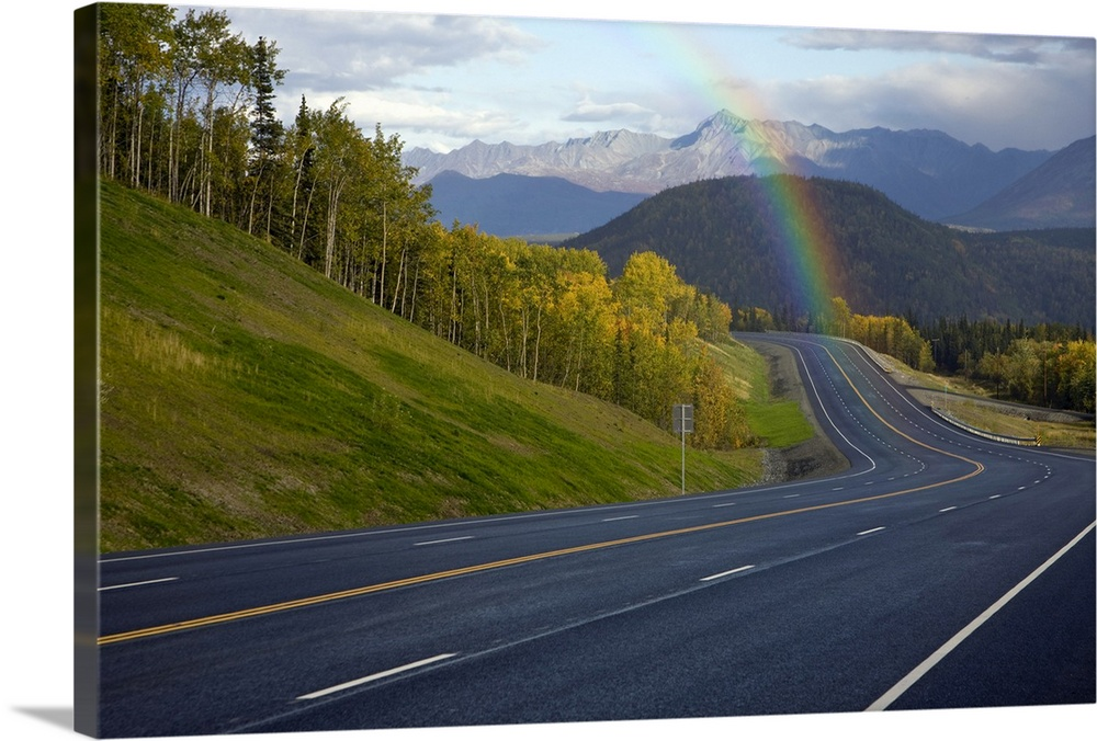 Large Solid-Faced Canvas Print Wall Art Print 30 x 20 entitled Rainbow over Glenn Highway in Matanuska Valley during Autum... Solid-Faced Canvas Print entitled Rainbow over Glenn Highway in Matanuska Valley during Autumn in Southcentral Alaska.  Multiple sizes available.  Primary colors within this image include Peach, Dark Forest Green, Pale Blue, Dark Navy Blue.  Made in USA.  All products come with a 365 day workmanship guarantee.  Archival-quality UV-resistant inks.  Featuring a proprietary design, our canvases produce the tightest corners without any bubbles, ripples, or bumps and will not warp or sag over time.  Archival inks prevent fading and preserve as much fine detail as possible with no over-saturation or color shifting.