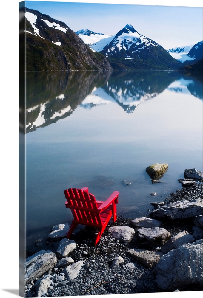 Large Solid-Faced Canvas Print Wall Art Print 20 x 30 entitled Red Adirondack chair at Portage Lake with Chugach Mountains... Solid-Faced Canvas Print entitled Red Adirondack chair at Portage Lake with Chugach Mountains in the background.  Red Adirondack chair in the wilds of Alaska.  Multiple sizes available.  Primary colors within this image include Dark Red, Black, Muted Blue, Pale Blue.  Made in USA.  Satisfaction guaranteed.  Inks used are latex-based and designed to last.  Archival inks prevent fading and preserve as much fine detail as possible with no over-saturation or color shifting.  Canvas depth is 1.25 and includes a finished backing with pre-installed hanging hardware.