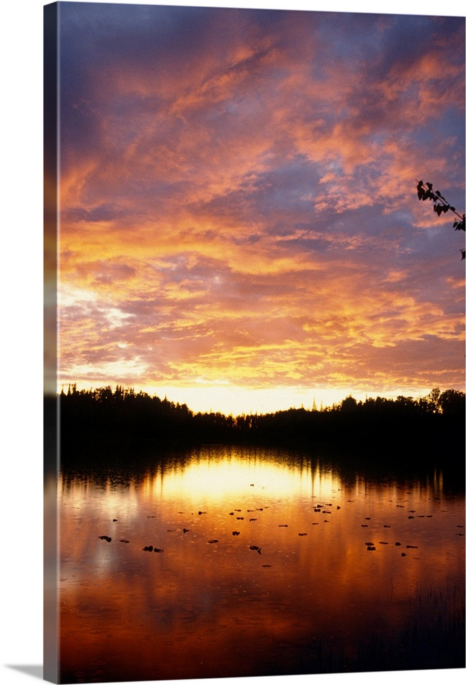Large Solid-Faced Canvas Print Wall Art Print 20 x 30 entitled Reflection of clouds lit up by setting sun Solid-Faced Canvas Print entitled Reflection of clouds lit up by setting sun.  Multiple sizes available.  Primary colors within this image include Dark Red, Peach, Light Yellow, Black.  Made in USA.  Satisfaction guaranteed.  Archival-quality UV-resistant inks.  Canvas is handcrafted and made-to-order in the United States using high quality artist-grade canvas.  Featuring a proprietary design, our canvases produce the tightest corners without any bubbles, ripples, or bumps and will not warp or sag over time.