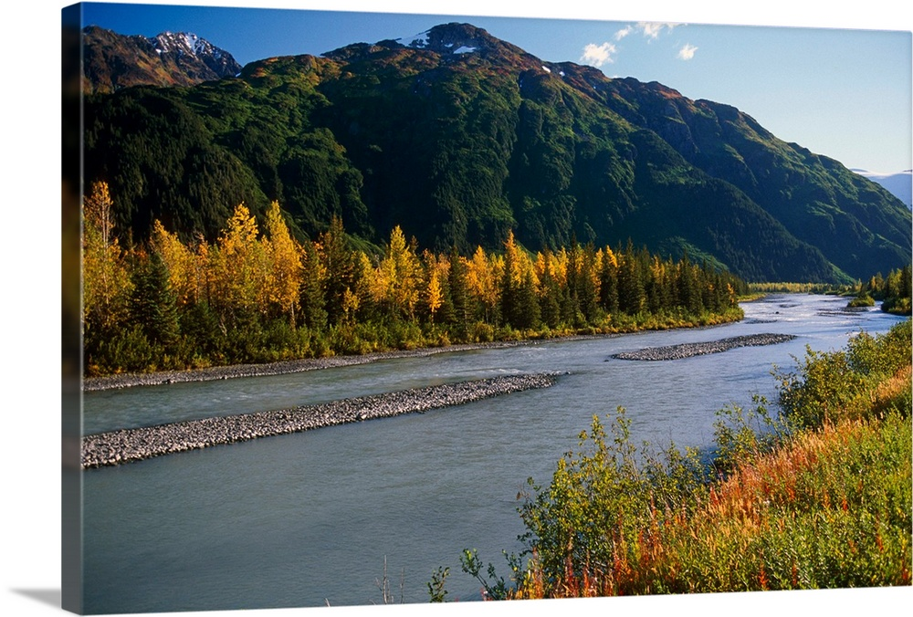 Large Solid-Faced Canvas Print Wall Art Print 30 x 20 entitled River passes through rocky bed near fall foliage and green ... Solid-Faced Canvas Print entitled River passes through rocky bed near fall foliage and green hill.  Multiple sizes available.  Primary colors within this image include Brown, Dark Yellow, Muted Blue, Dark Navy Blue.  Made in the USA.  Satisfaction guaranteed.  Inks used are latex-based and designed to last.  Canvas is handcrafted and made-to-order in the United States using high quality artist-grade canvas.  Canvas depth is 1.25 and includes a finished backing with pre-installed hanging hardware.