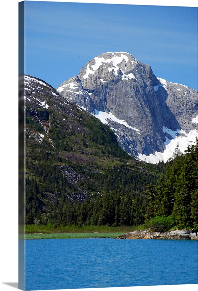 Large Solid-Faced Canvas Print Wall Art Print 20 x 30 entitled Scenic landscape of Derickson Bay in Prince William Sound, ... Solid-Faced Canvas Print entitled Scenic landscape of Derickson Bay in Prince William Sound, Alaska.  Multiple sizes available.  Primary colors within this image include Sky Blue, Light Gray, White, Dark Forest Green.  Made in the USA.  All products come with a 365 day workmanship guarantee.  Archival-quality UV-resistant inks.  Canvas is handcrafted and made-to-order in the United States using high quality artist-grade canvas.  Featuring a proprietary design, our canvases produce the tightest corners without any bubbles, ripples, or bumps and will not warp or sag over time.