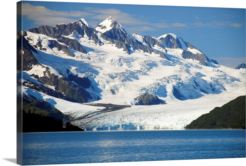 Large Solid-Faced Canvas Print Wall Art Print 30 x 20 entitled Scenic view of Harriman glacier in Harriman Fjord, Prince W... Solid-Faced Canvas Print entitled Scenic view of Harriman glacier in Harriman Fjord, Prince William Sound, Alaska.  Multiple sizes available.  Primary colors within this image include Black, White, Gray Blue.  Made in the USA.  All products come with a 365 day workmanship guarantee.  Inks used are latex-based and designed to last.  Featuring a proprietary design, our canvases produce the tightest corners without any bubbles, ripples, or bumps and will not warp or sag over time.  Canvas is handcrafted and made-to-order in the United States using high quality artist-grade canvas.