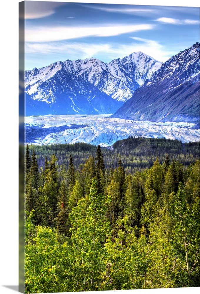 Large Solid-Faced Canvas Print Wall Art Print 20 x 30 entitled Scenic view of Matanuska Glacier as seen from the Glenn Hig... Solid-Faced Canvas Print entitled Scenic view of Matanuska Glacier as seen from the Glenn Highway in Southcentral.  Multiple sizes available.  Primary colors within this image include Forest Green, Black, Pale Blue, Royal Blue.  Made in USA.  Satisfaction guaranteed.  Inks used are latex-based and designed to last.  Archival inks prevent fading and preserve as much fine detail as possible with no over-saturation or color shifting.  Featuring a proprietary design, our canvases produce the tightest corners without any bubbles, ripples, or bumps and will not warp or sag over time.