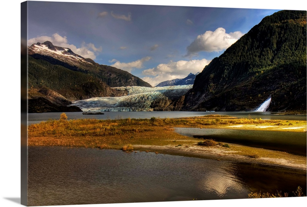 Large Solid-Faced Canvas Print Wall Art Print 30 x 20 entitled Scenic view of Mendenhall Glacier near Juneau, Alaska in Au... Solid-Faced Canvas Print entitled Scenic view of Mendenhall Glacier near Juneau, Alaska in Autumn.  Multiple sizes available.  Primary colors within this image include Brown, Peach, Sky Blue, Black.  Made in the USA.  All products come with a 365 day workmanship guarantee.  Archival-quality UV-resistant inks.  Canvas depth is 1.25 and includes a finished backing with pre-installed hanging hardware.  Archival inks prevent fading and preserve as much fine detail as possible with no over-saturation or color shifting.
